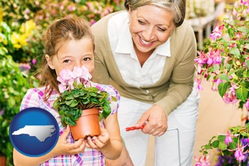 a grandmother and her granddaughter at a garden center - with North Carolina icon